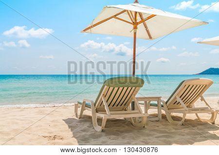 Beach chairs on tropical white sand beach