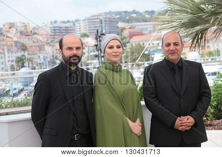Actor Ali Mosaffa, actress Sahar Dolatshahi and director Behnam Behzadi attend the 'Inversion' Photocall during the 69th annual Cannes Film Festival at the Palais on May 18, 2016 in Cannes, France.