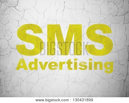 Marketing concept: Yellow SMS Advertising on textured concrete wall background