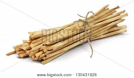 Crispy crunchy long bread sticks tied with rope isolated on a white background.