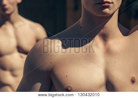 Strong Torso Of Two Men