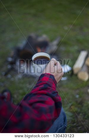 Man Cooks The Coffee On The Fire.