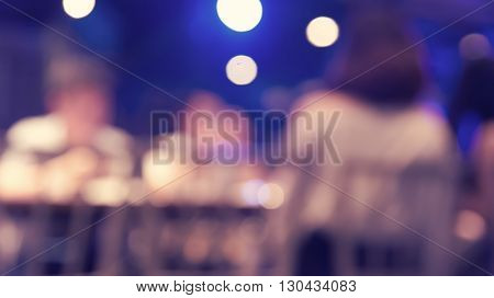 Blurred defocused of light in pub city abstract background purple and blue tone