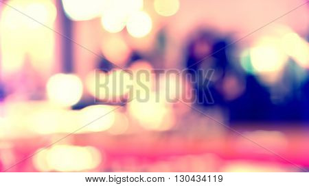 Blurred defocused of light in pub city abstract purple tone background