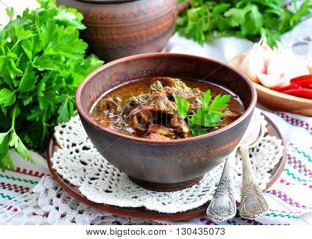 Lamb braised in white wine with tarragon, coriander and green onions.