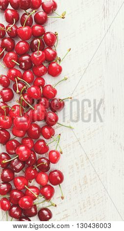 Cherries Fresh cherries on a white surface, seen from above, blank space