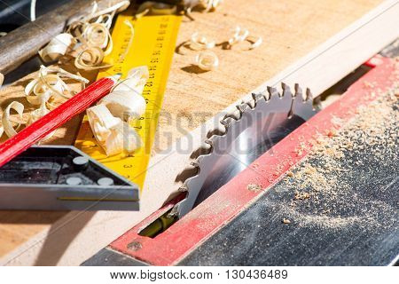 steel circular saw in the carpentry workshop