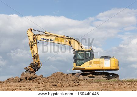 Skejby, Denmark - May 16, 2016: Komatsu excavator. Komatsu is a Japanese multinational corporation that manufactures construction, mining, and military equipment
