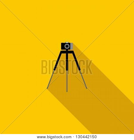 Camera on a tripod icon in flat style on a yellow background