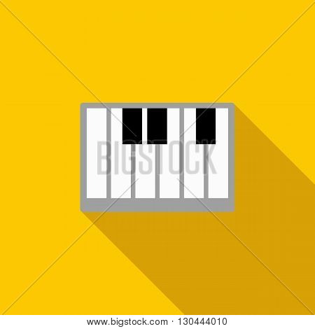 Piano keys icon in flat style on a yellow background