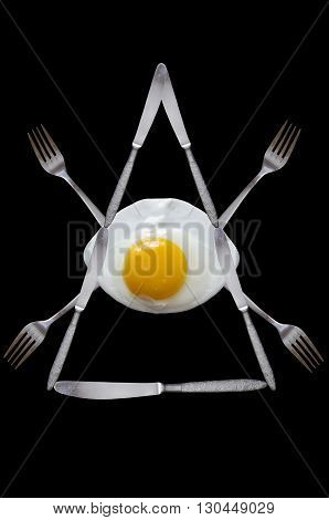 masonic symbol created from the fried egg, knives and forks