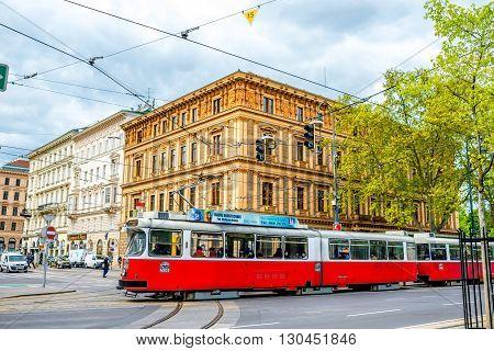 VIENNA, AUSTRIA - CIRCA APRIL 2016: Old red tram on the street in Vienna. Four wheel tram of Type L are still popular public transportation in Austria