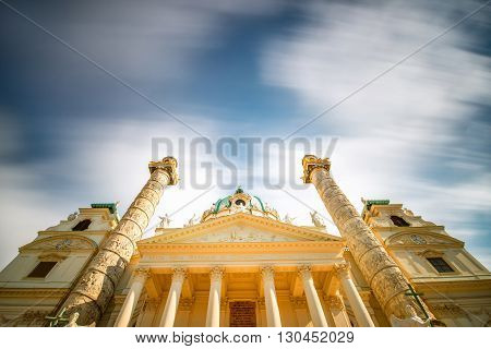View from below on st. Charles's church on Karlsplatz in Vienna. Long exposure technic with blurred clouds