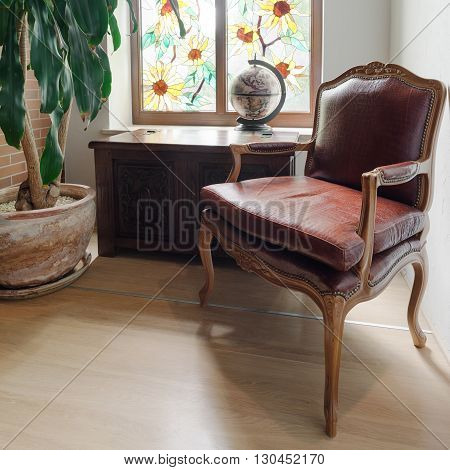 Close up of ancient solid wooden cabinet and armchair