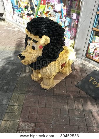 ROME ITALY - CIRCA OCTOBER 2015: Lego toy lion at the entrance of a toy store