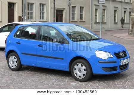 KOETHEN GERMANY - CIRCA MARCH 2016: blue Volkswagen car parked on the street