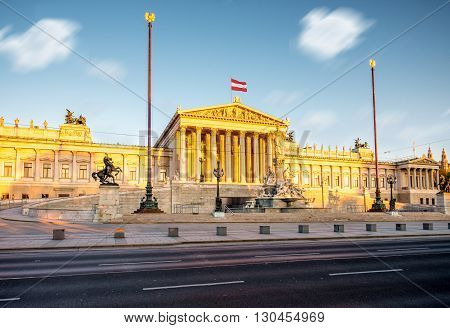 Austrian parliament building with Athena statue on the front in Vienna on the sunrise. Long exposure image technic with blurred clouds