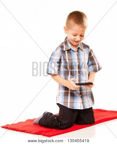 Leisure technology and internet concept - little boy with smartphone playing games or reading text message