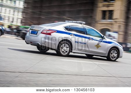 Police car is fast moving on the road