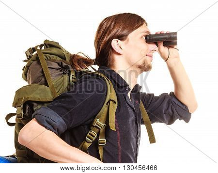 Man tourist backpacker looking through binoculars. Young guy hiker backpacking. Summer vacation travel. Isolated on white background.