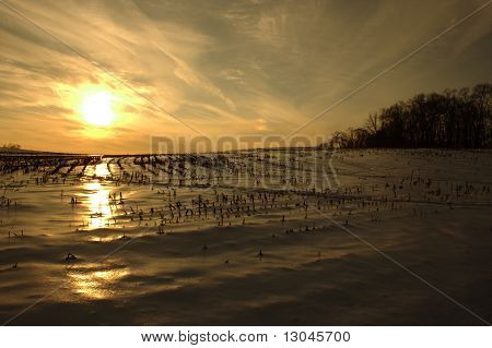 Sunset Over Snow-Covered Field