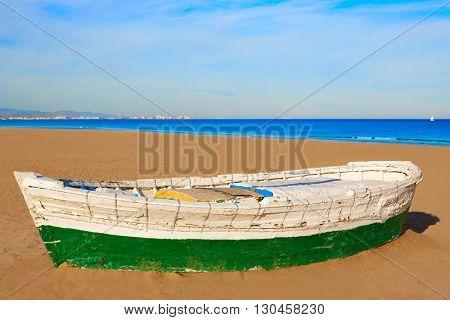 Valencia La Malvarrosa beach boats stranded in Mediterranean Spain
