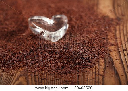 grated dark chocolate and heart shaped glass, perfect color and background