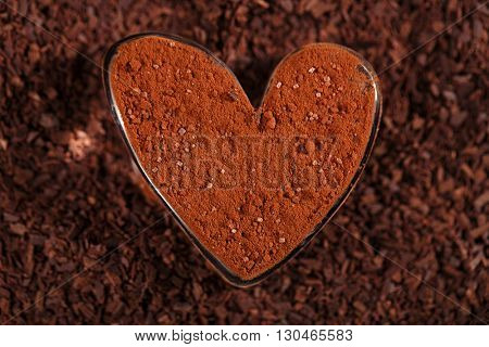 cocoa sugared  powder  dusted heart shaped glass with grated chocolate, perfect color and background