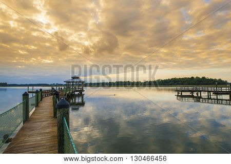 Sunset in South Carolina with dock and dolphin