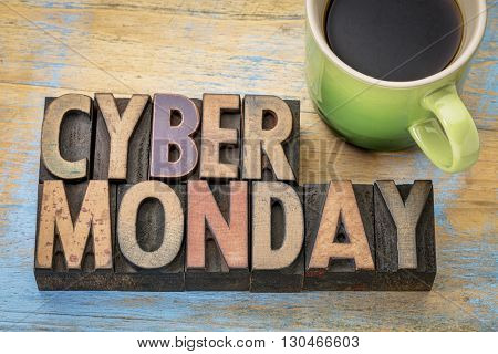 Cyber Monday - internet holiday shopping - text in vintage letterpress wood type with a cup of coffee