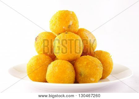 Pile of Indian Traditional Diwali sweets called Motichoor Ladoo in white background.