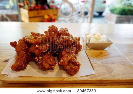 Korean teaste chicken fried serve with pickled vegetables