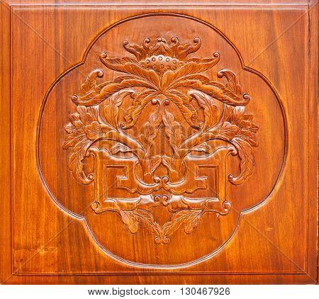 Flower carved on a wooden door. Is popular in decorating the door.