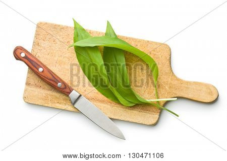 Fresh ramsons leaves and cutting board with knife. Wild garlic leaves isolated on white background.