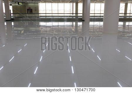 reflection on floor of interior corridor in airport terminal building