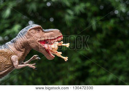 gigantic tyrannosaurus catches a smaller dinosaur horizontal