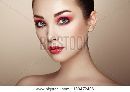 Beautiful woman face. Perfect makeup. Beauty fashion. Eyelashes. Lips. Cosmetic Eyeshadow. Perfect skin