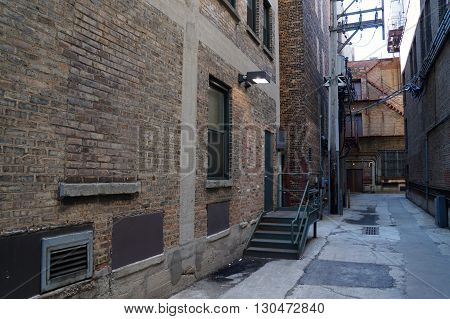A narrow alleyway between tall buildings in downtown Joliet, Illinois