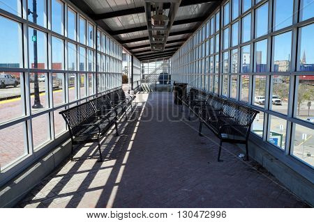 A glass shelter with benches is available for passengers awaiting a commuter train in Joliet, Illinois.