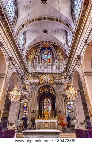 PARIS, FRANCE - MAY 31, 2015 Basilica Stained Glass Church Saint Louis En L'ile Paris France. Saint Louis En L'ile church built in Notre Dame was built in 1726 on the island in back of Nortre Dame.