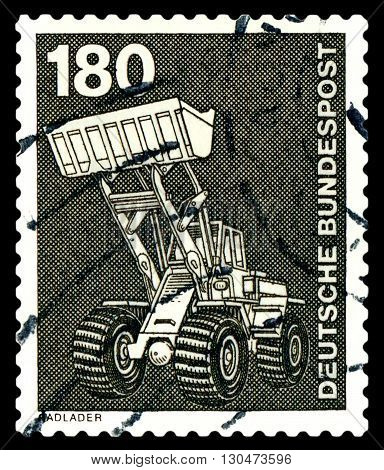 STAVROPOL RUSSIA - APRIL 04 2016: a stamp printed by Germany shows Wheel loader series Industry and Technology circa 1975