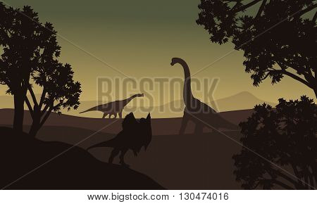 Dilophosaurus and Brachiosaurus silhouette in hills at the night