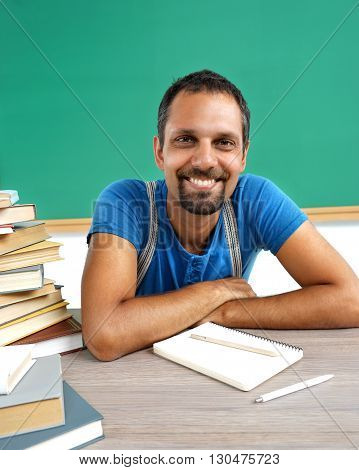 Literature teacher. Photo adult man with books in classroom creative concept with Back to school theme