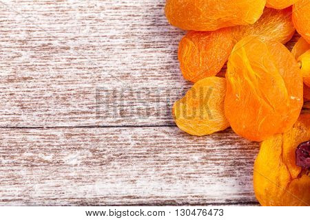Dried Fruits On Wooden Background In Close Up Photo
