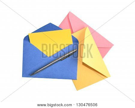 Pen on blank colored envelopes against white background.