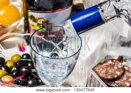 Part of the holiday table with food and alcoholic beverages closeup