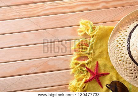 Articles of Beach on wooden slats.Sunglasses hat and towel. Horizontal composition. Top view
