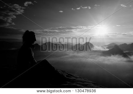 Beautiful  Young Long Hair Girl Tourist Enjoy Daybreak On The Sharp Corner Of Sandstone Rock And Wat