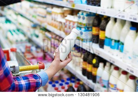 Woman Shopping Dairy Product In Store