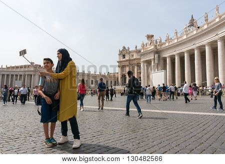 VATICAN CITY VATICAN - APRIL 4: People are enjoying the sunny weather at Saint Peter Square on April 4 2016 in Vatican City Vatican.